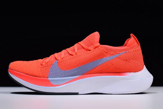 9eac2e454c9f Nike Zoom VaporFly 4% Flyknit Bright Crimson Ice Blue AJ3857-600